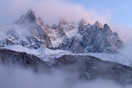Mountainpeaks in between clouds, Chamonix